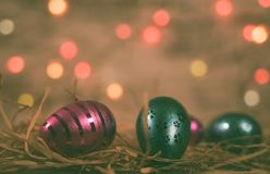 Pink/Blue easter eggs with Bokeh royalty free stock photos