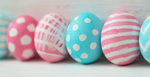 Pink and blue easter eggs on a wooden background Royalty Free Stock Photography
