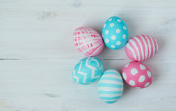 Pink and blue easter eggs on a wooden background Royalty Free Stock Photos