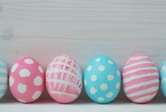 Pink and blue eggs on a wooden background Stock Photos