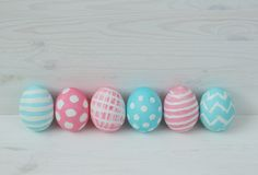 Pink and blue eggs on a wooden background Royalty Free Stock Images