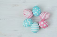 Pink and blue eggs on a wooden background Royalty Free Stock Photo
