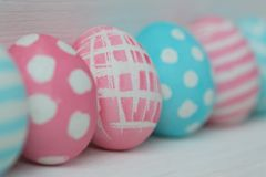 Pink and blue eggs on a wooden background Stock Images