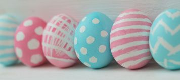 Pink and blue eggs on a wooden background Royalty Free Stock Image