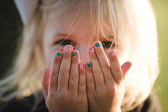 Pink and blue fingernails of cute blonde girl royalty free stock images