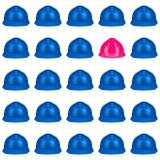 Pink and blue hardhats on white Royalty Free Stock Photo