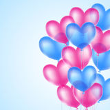 Pink and blue heart balloons Royalty Free Stock Image