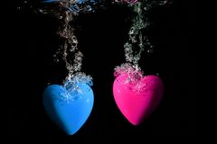 Pink and blue hearts underwater Stock Image