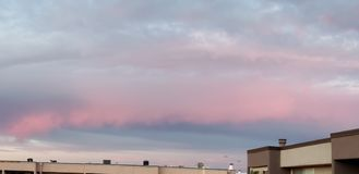 Pink and Blue Hues. Pink blue hues The sunset this day led to hues of pink and blue in the sky with wispy clouds nature colorful royalty free stock photo
