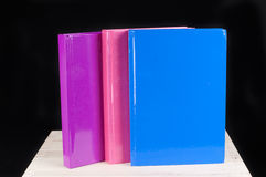 Pink, blue and magenta book on a black background Royalty Free Stock Photography