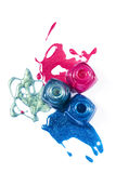 Pink, blue, marine shimmering nail polish Stock Images
