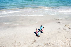 Pink and Blue Person Near Beach Stock Images