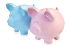 Pink and Blue Piggy Banks. Two piggy banks, one pink and one blue, isolated on white.  A handsome couple Stock Photo