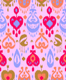 Pink blue and red colorful ikat asian traditional fabric seamless pattern, vector Royalty Free Stock Image