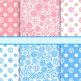 Pink and blue set of polka dot fabric seamless patterns Stock Photos