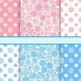 Pink and blue set of polka dot fabric seamless patterns Stock Photos