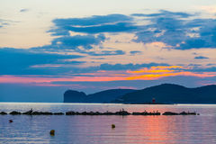 Pink and blue sky over Capo Caccia Stock Images