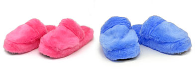 Pink & Blue slippers. Two pairs of pink and blue slippers royalty free stock images