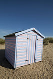 Pink and blue striped beach hut Royalty Free Stock Photos