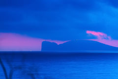 Pink and blue sunset in Capo Caccia Stock Photo