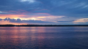 Pink and blue sunset over the river Stock Photography