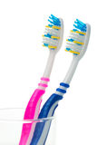 Pink and blue toothbrushes Royalty Free Stock Photos