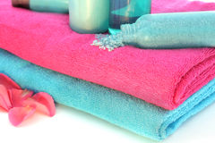 Pink and blue towels with shampoo, solt...... Royalty Free Stock Images