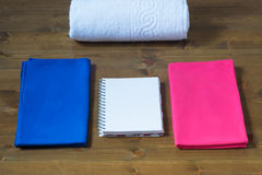 Pink and blue towels with white  on the table Royalty Free Stock Photography