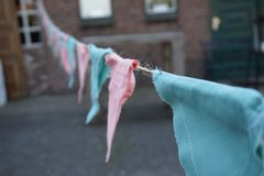 Pink and blue triangle, handmade cloth garland royalty free stock photos