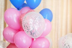 Pink, blue and white inflatable balloons. Decorations for birthday party.  royalty free stock image