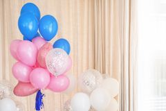Pink, blue and white inflatable balloons. Decorations for birthday party.  royalty free stock photography