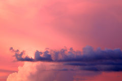 Pink blue and white sunset clouds Royalty Free Stock Photos