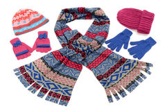 Pink and blue winter accessories isolated on white background. Stock Photos