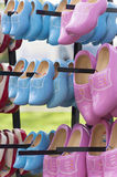 Pink and blue wooden clogs Stock Image