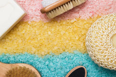 Pink blue yellow bath salt and bath accessories Royalty Free Stock Photography