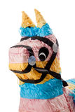 Pink, blue and yellow burro pinata on white Royalty Free Stock Photos
