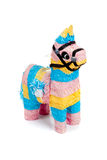 Pink, blue and yellow burro pinata on white. A pink, blue and yellow burro pinata on a white background Stock Images