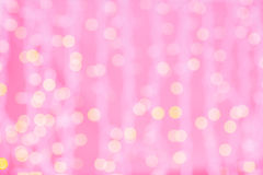 Pink blurred background with bokeh lights Stock Images