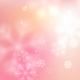 Pink blurred snowflakes background Royalty Free Stock Images