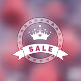 Pink blurry photo as a background with princess logo. Stock Photo
