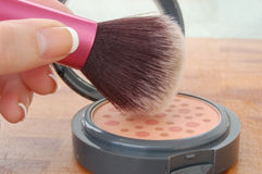 Pink Blush and Brush. Blush brush with open pink blush container Stock Photography
