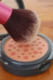 Pink Blush and Brush. Blush brush with open pink blush container Royalty Free Stock Photography