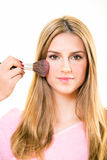 Pink blusher being applied to contour a cheek. Royalty Free Stock Photos
