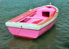 Pink boat in the middle of the ocean Royalty Free Stock Photography