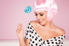 Pink bob short hairstyle woman. Pink bob short hairstyle. Beautiful woman in fashionable dress with black dots. Trendy haircuts stock photos