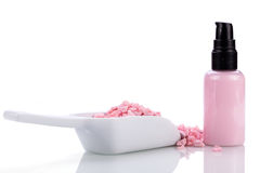 Pink body lotion in dispenser and aroma salt isolated Royalty Free Stock Images