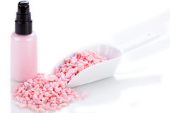 Pink body lotion in dispenser and aroma salt isolated Stock Photography