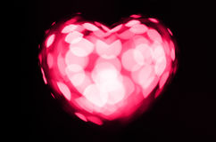 Pink bokeh heart on black background Royalty Free Stock Photo