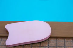 Pink boogie board. In swimming pool stock photography