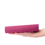 Pink book with hand isolated on white Stock Images